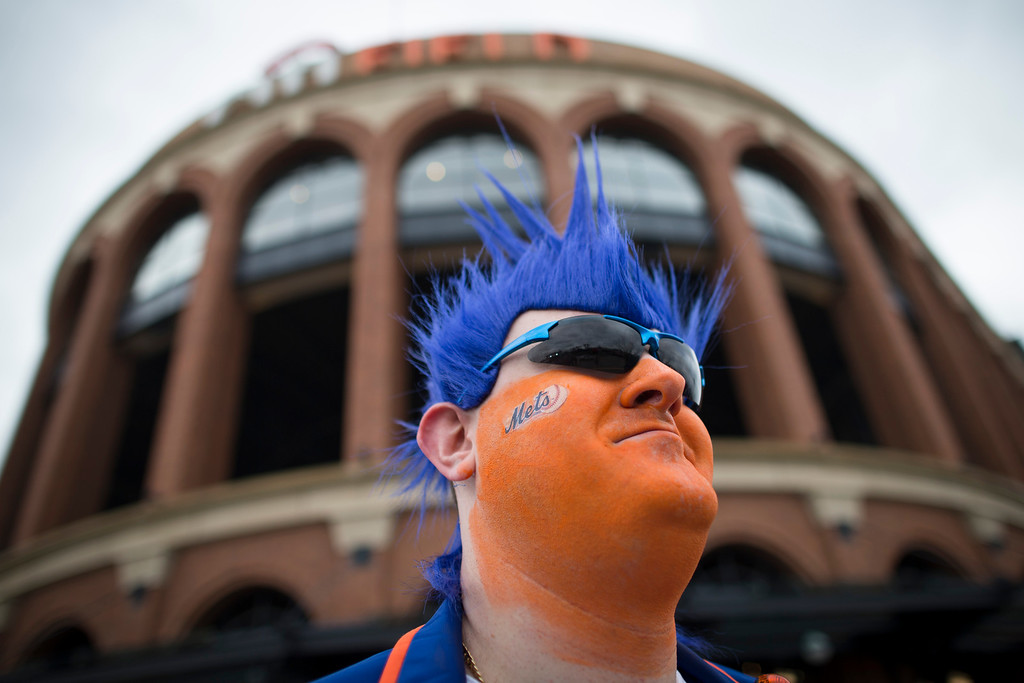 . Chris Gress, of Morristown, N.J., shows off his face paint and New York Mets gear outside Citi Field before on Opening Day baseball game between the Washington Nationals and the Mets, Monday, March 31, 2014, in New York. (AP Photo/John Minchillo)