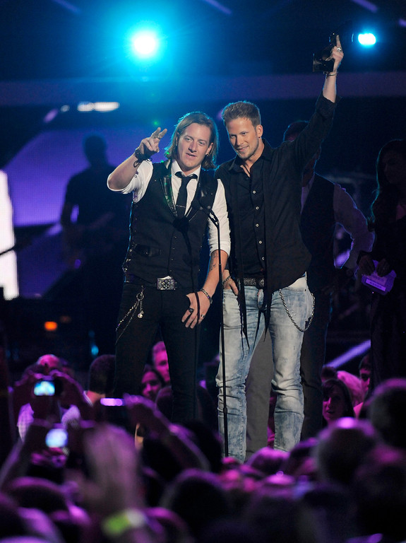 """. Tyler Hubbard, left, and Brian Kelley, of Florida Georgia Line accept the award for duo video of the year for \""""Cruise\"""" at the 2013 CMT Music Awards at Bridgestone Arena on Wednesday, June 5, 2013, in Nashville, Tenn. (Photo by Donn Jones/Invision/AP)"""
