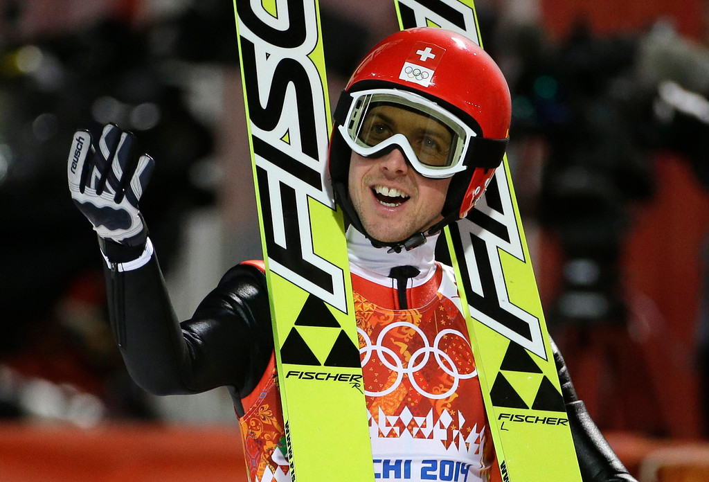 . Switzerland\'s Simon Ammann smiles after an attempt the men\'s normal hill ski jumping qualification at the 2014 Winter Olympics, Saturday, Feb. 8, 2014, in Krasnaya Polyana, Russia. (AP Photo/Gregorio Borgia)