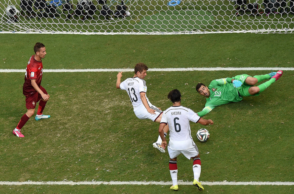 . Germany\'s forward Thomas Mueller (C) is watched by Germany\'s midfielder Sami Khedira (2R) as he scores his third goal past Portugal\'s goalkeeper Rui Patricio (R) during the Group G football match between Germany and Portugal at the Fonte Nova Arena in Salvador on June 16, 2014, during the 2014 FIFA World Cup.   FRANCOIS XAVIER MARIT/AFP/Getty Images