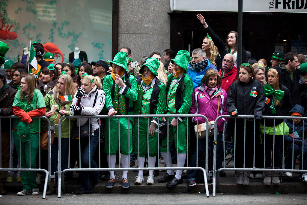 . Revelers watch the 252nd annual St. Patrick\'s Day Parade March 16, 2013 in New York City. The parade honors the patron saint of Ireland and was held for the first time in New York on March 17, 1762, 14 years before the signing of the Declaration of Independence. (Photo by Ramin Talaie/Getty Images)