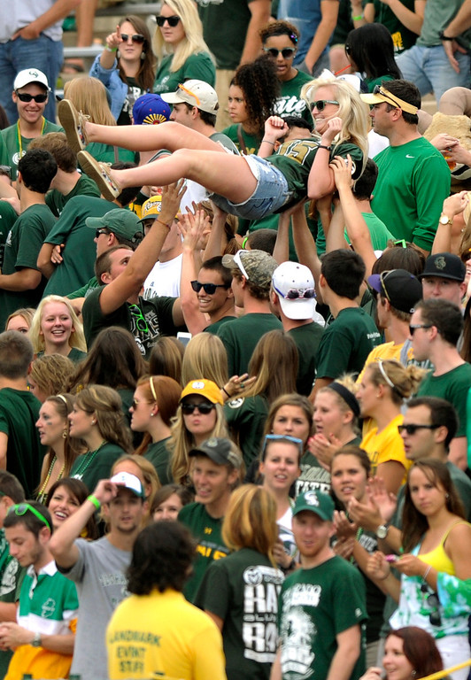 . FORT COLLINS, CO. - SEPTEMBER 14: Rams fans celebrated a touchdown in the first half. The Colorado State University football team defeated Cal Poly at Hughes Stadium in Fort Collins Saturday afternoon, September 14, 2013.  It was the Rams\' first home game and first win of the season. Photo By Karl Gehring/The Denver Post