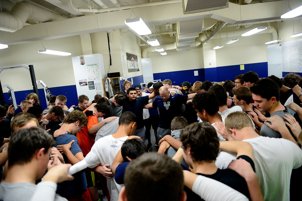 . The Valor Christian football team takes part in the team prayer during practice.   (Photo by AAron Ontiveroz/The Denver Post)