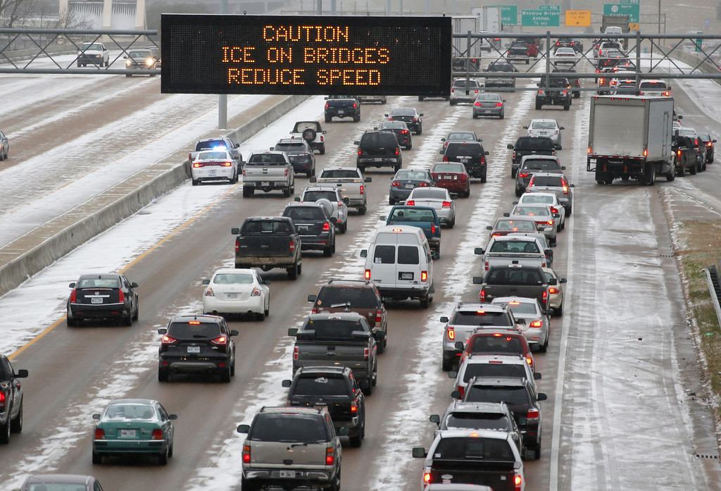 . Traffic creeps along Interstate 55 in north Jackson, Miss., Tuesday, Jan. 28, 2014, as ice and snow flurries cause difficult driving conditions.  (AP Photo/Rogelio V. Solis)