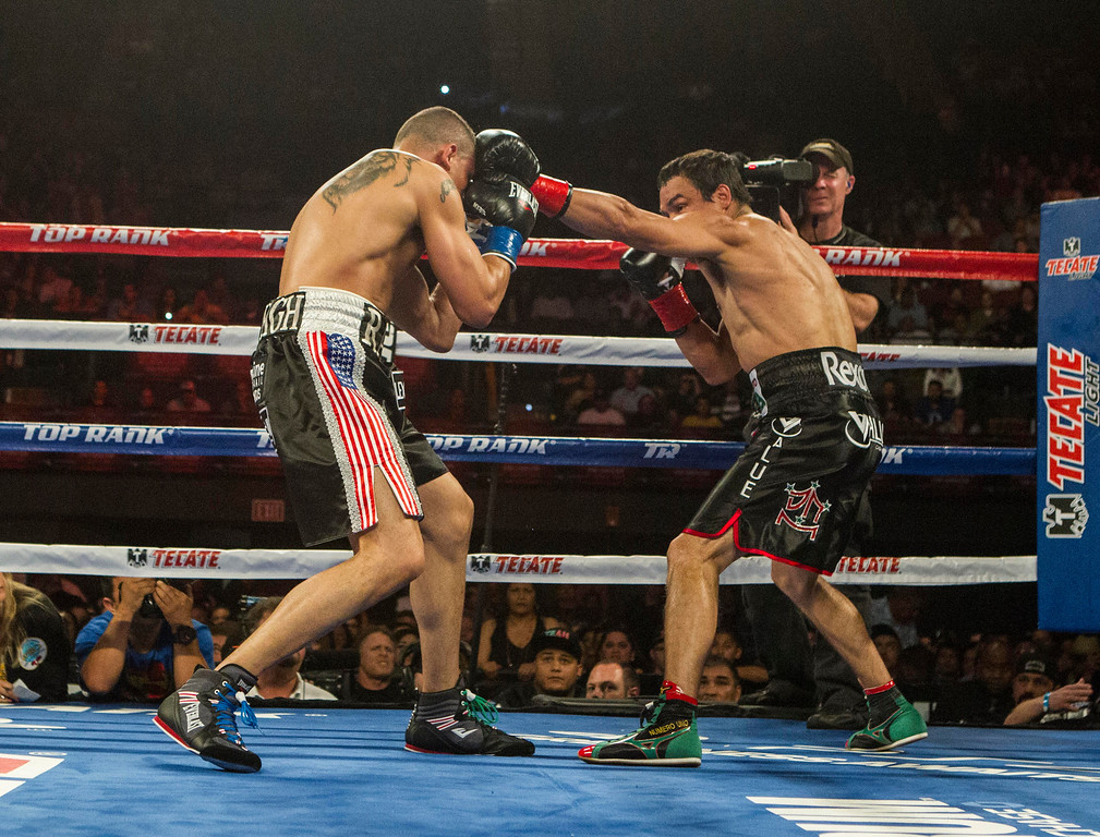 . Juan Manuel Márquez, right, of Mexico, lands a punch against  Mike Alvarado in the first round of a WBO welterweight title boxing match at the Forum in Inglewood, Calif., Saturday, May 17, 2014. Márquez won the title.  (AP Photo/Ringo H.W. Chiu)