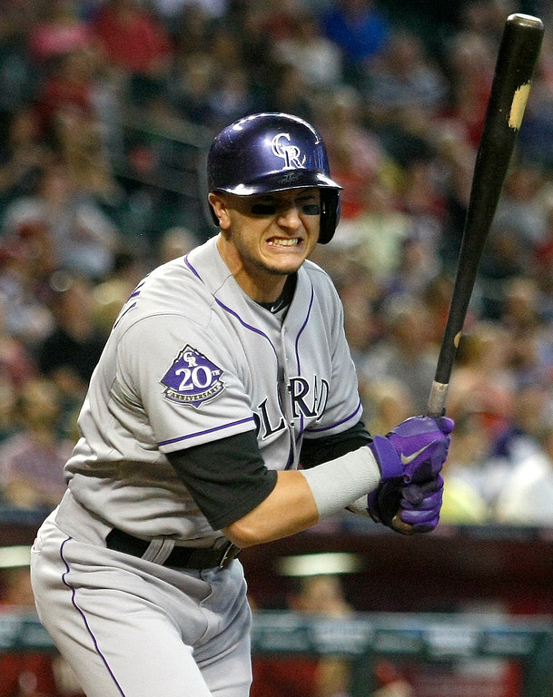 . Colorado Rockies shortstop Troy Tulowitzki after striking out in the first inning during a baseball game against the Arizona Diamondbacks, Sunday, Sept. 15, 2013, in Phoenix. (AP Photo/Rick Scuteri)