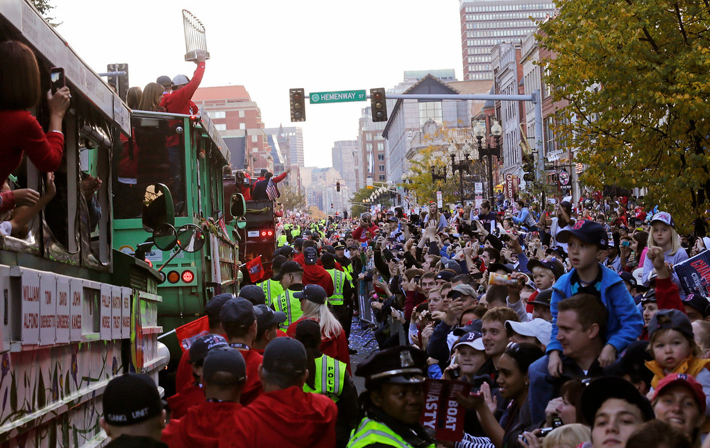 . Boston Red Sox fans line Boylston Street during a parade in celebration of the baseball team\'s World Series win, Saturday, Nov. 2, 2013, in Boston. (AP Photo/Charles Krupa)