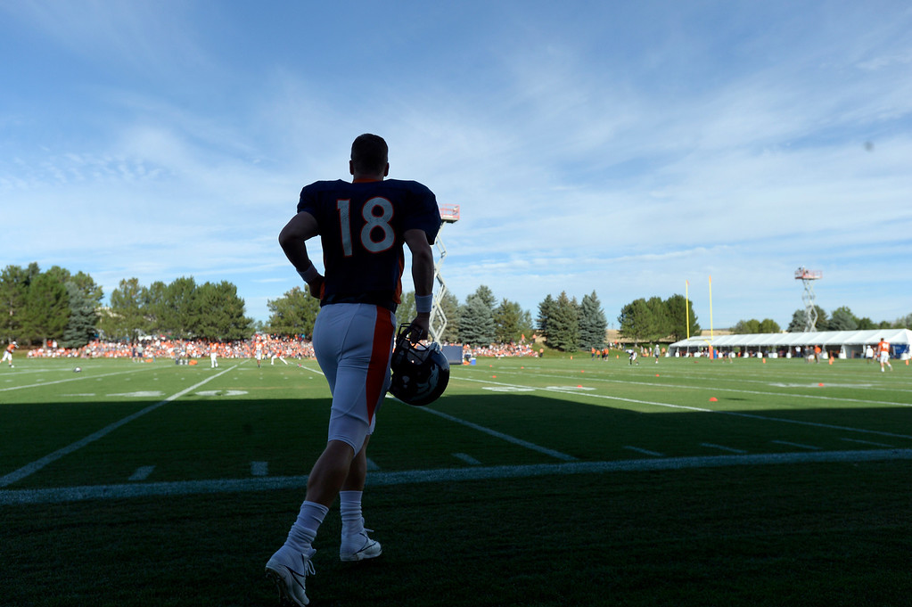 . Denver Broncos QB Peyton Manning (18) runs out on the field during training camp August 6, 2013 at Dove Valley. (Photo By John Leyba/The Denver Post)