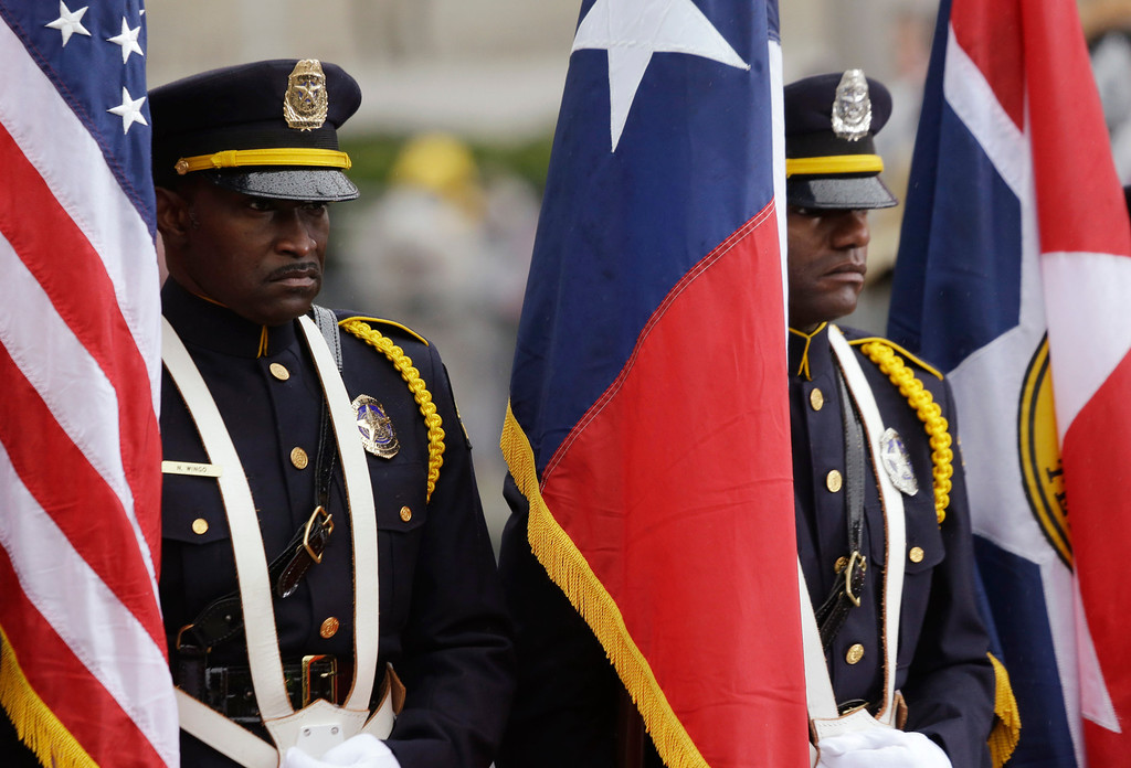 . Members of the Dallas Police Department Honorary Color Guard stand at attention during a ceremony to mark the 50th anniversary of the assassination of John F. Kennedy, Friday, Nov. 22, 2013, at Dealey Plaza in Dallas. President Kennedy\'s motorcade was passing through Dealey Plaza when shots rang out on Nov. 22, 1963. (AP Photo/LM Otero)