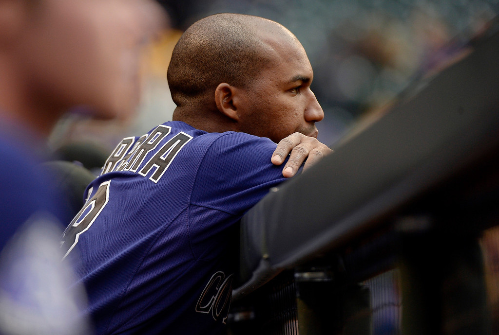 . DENVER, CO. - MAY 20: Jonathan Herrera (18) of the Colorado Rockies looks on from the dugout versus the Arizona Diamondbacks May 20, 2013 at Coors Field. (Photo By John Leyba/The Denver Post)