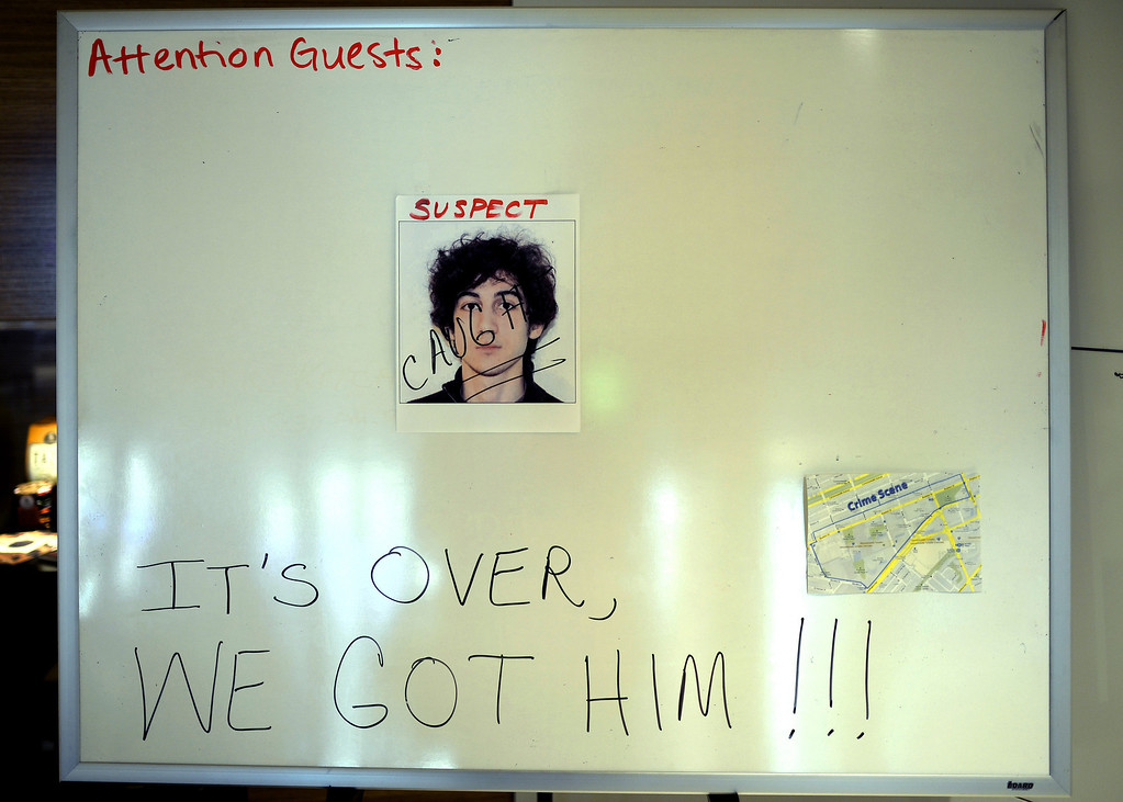 . A sign in a Boston hotel lobby on April 20, 2013, shows a photo of Dzhokhar A. Tsarnaev, 19, the morning after he was captured. Thousands of heavily armed police staged an intense manhunt Friday for the Chechen teenager suspected in the Boston marathon bombings with his brother, who was killed in a shootout. Dzhokhar defied the massive force after his 26-year-old brother Tamerlan was shot and suffered critical injuries from explosives believed to have been strapped to his body.    TIMOTHY A. CLARY/AFP/Getty Images