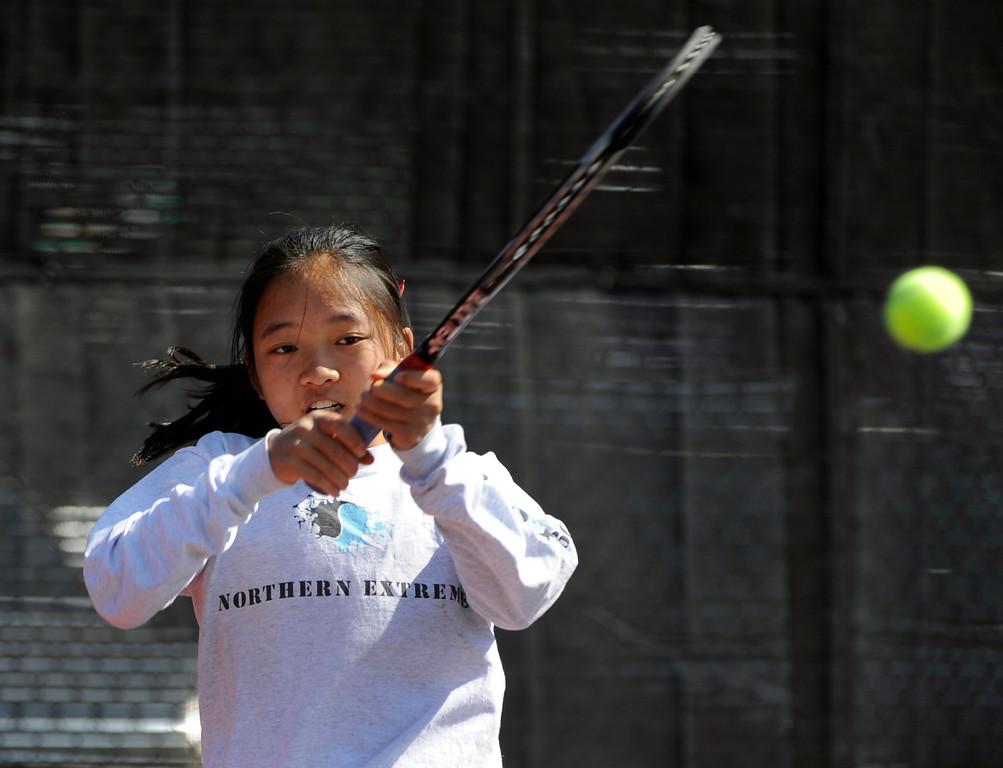 . Katie Li from Fairview High School returns the ball to Angelica Buczynski from ThunderRidge High School in the #3 Singles Bracket.  (Photo By Kathryn Scott Osler/The Denver Post)