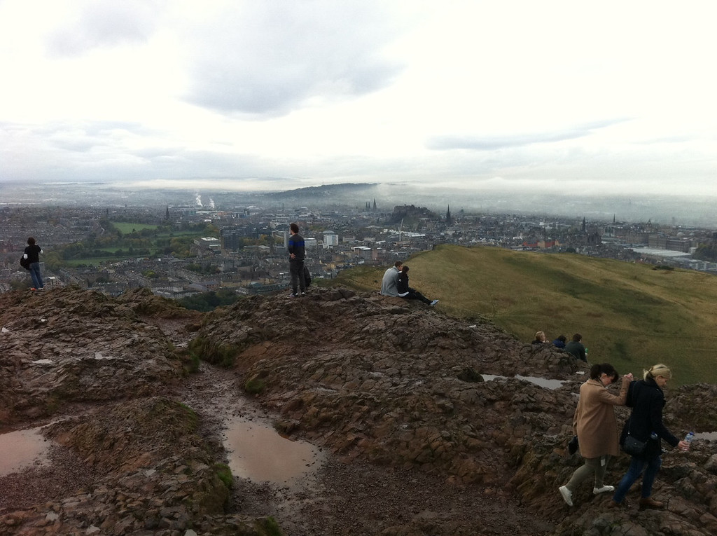 . This October 2013 photo shows hikers in Holyrood Park overlooking Edinburgh, Scotland from Arthur\'s Seat. It is the highest point in Edinburgh and a lovely echo of the Highlands within a short walk of the city\'s downtown. (AP Photo/Cara Anna)