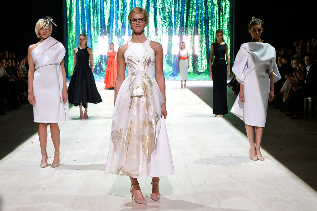 . Model Erin Heatherton showcases designs by Maticevski on the runway at the MBFWA Trends show during Mercedes-Benz Fashion Festival Sydney 2013 at Sydney Town Hall on August 21, 2013 in Sydney, Australia.  (Photo by Stefan Gosatti/Getty Images)