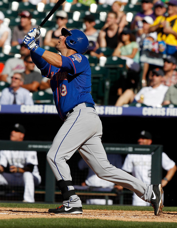 . New York Mets\' Zach Lutz follows the flight of his pop single against the Colorado Rockies in the fifth inning of a baseball game in Denver on Thursday, June 27, 2013. (AP Photo/David Zalubowski)