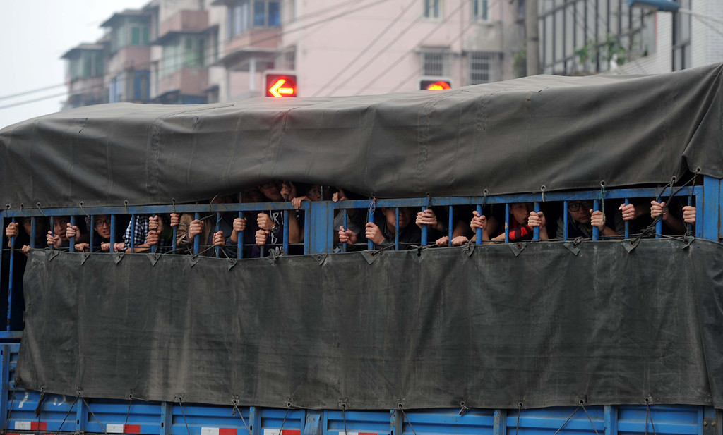 . This photo taken on April 21, 2013 shows volunteers entering the disaster-hit area on a truck in Ya\'an, southwest China\'s Sichuan province.  STR/AFP/Getty Images