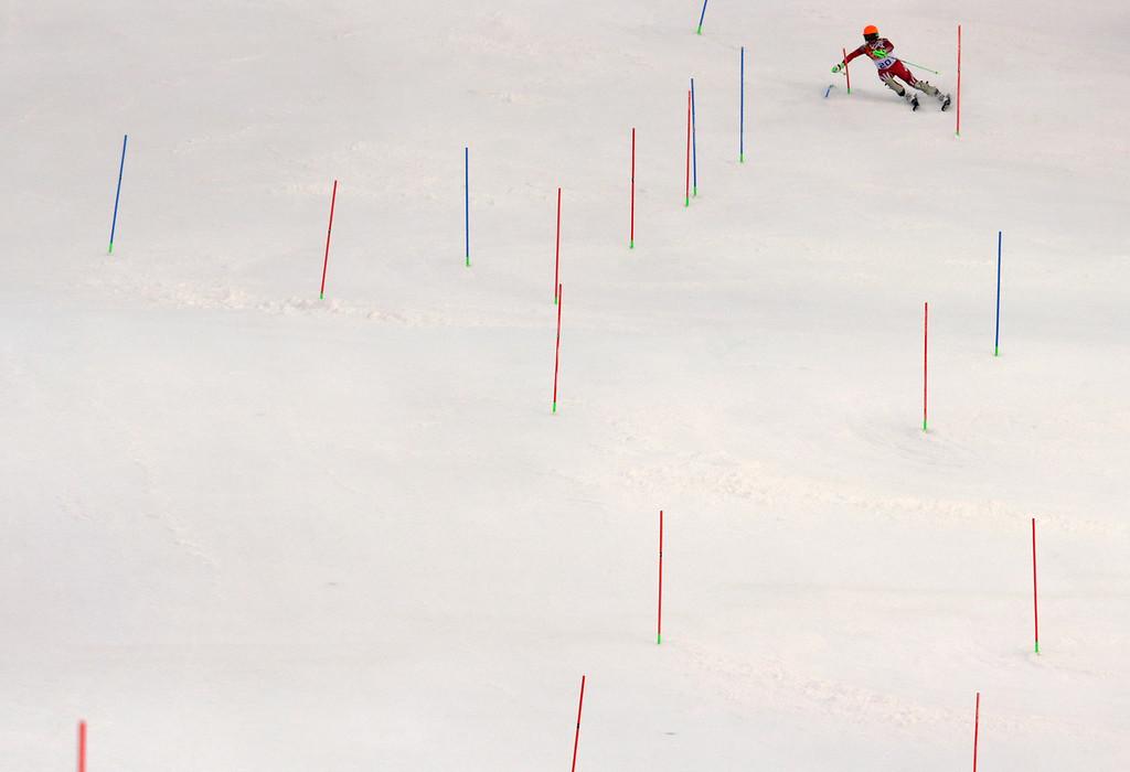 . Men\'s supercombined gold medal winner Switzerland\'s Sandro Viletta finishes the slalom portion of the event at the Alpine ski venue at the Sochi 2014 Winter Olympics, Friday, Feb. 14, 2014, in Krasnaya Polyana, Russia. (AP Photo/Charles Krupa)