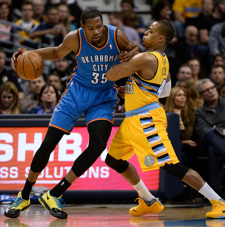 . Denver Nuggets shooting guard Randy Foye (4) plays tough defense on Oklahoma City Thunder small forward Kevin Durant (35) during the first quarter  December 17, 2013 at Pepsi Center. (Photo by John Leyba/The Denver Post)