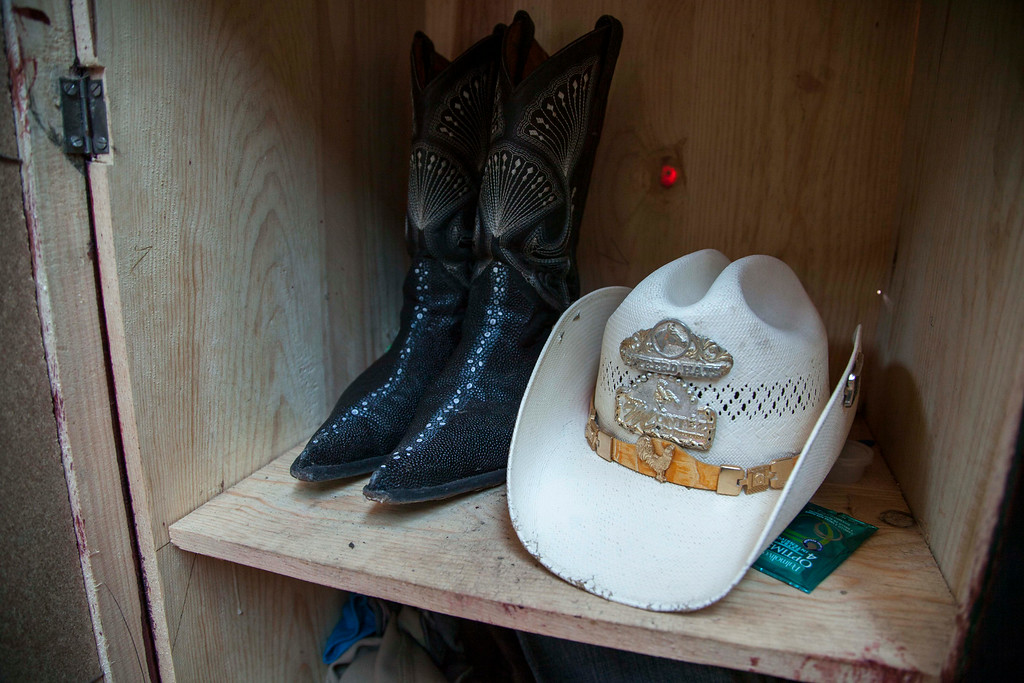 . A pair of boots and a hat belonging to Francisco Ramos Juarez, a Guatemalan boy whose decomposed body was found in the Rio Grande Valley of South Texas, are shown inside a closet at his home in San Jose Las Flores, northern Cuchumatanes mountains, Guatemala, Tuesday, July 1, 2014. The boy was found with the rosary still around his neck and a brother\'s Chicago phone number scribbled on the inside of his belt buckle about two weeks ago. He was alone in brush less than a mile from the nearest U.S. home, a South Texas sheriff said Monday. (AP Photo/Luis Soto)
