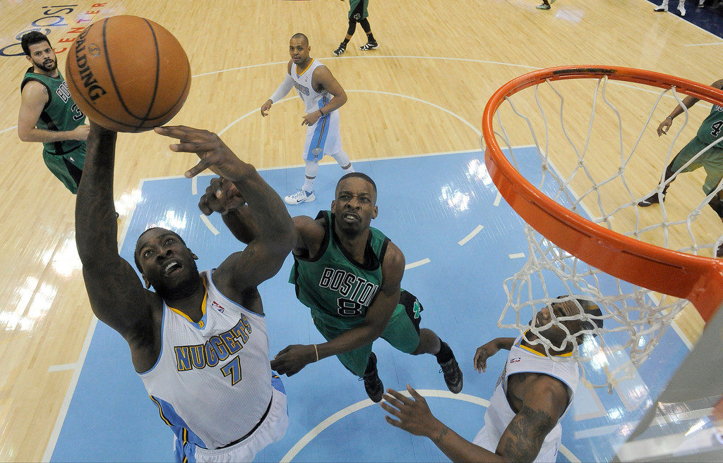 . Denver Nuggets power forward J.J. Hickson (7) hauls down a rebound from Boston Celtics small forward Jeff Green (8) during the third quarter  January 7, 2014 at Pepsi Center. (Photo by John Leyba/The Denver Post)