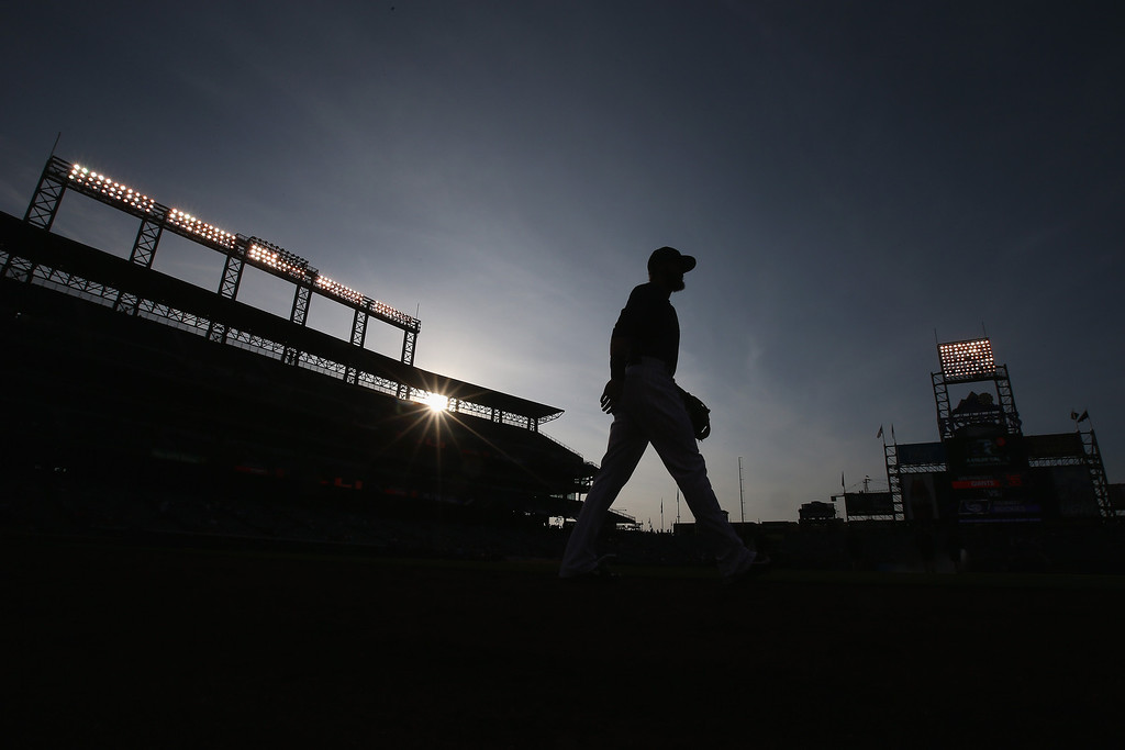 . Charlie Blackmon #19 of the Colorado Rockies takes the field to warm up prior to facing the San Francisco Giants at Coors Field on April 21, 2014 in Denver, Colorado.  (Photo by Doug Pensinger/Getty Images)