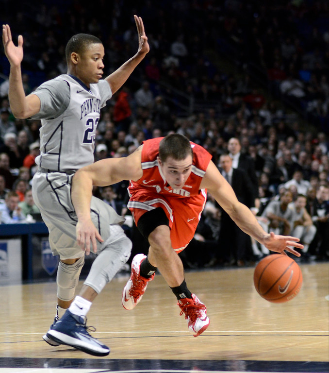 . Ohio State\'s Aaron Craft, right, is fouled by Penn State\'s Tim Frazier (23) while moving into the paint during the second half of an NCAA college basketball game on Thursday, Feb. 27, 2014, in State College, Pa. Penn State won 65-63. (AP Photo/Ralph Wilson)