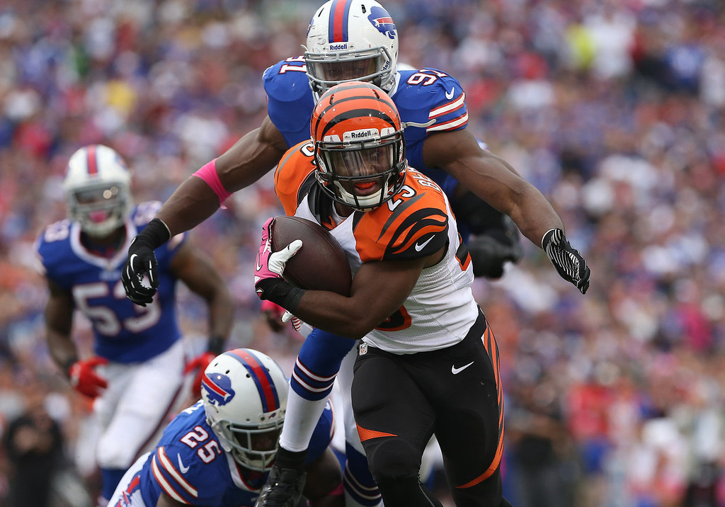 . Giovani Bernard #25 of the Cincinnati Bengals rushes in for a touchdown during NFL game action against the Buffalo Bills at Ralph Wilson Stadium on October 13, 2013 in Orchard Park, New York. (Photo by Tom Szczerbowski/Getty Images)