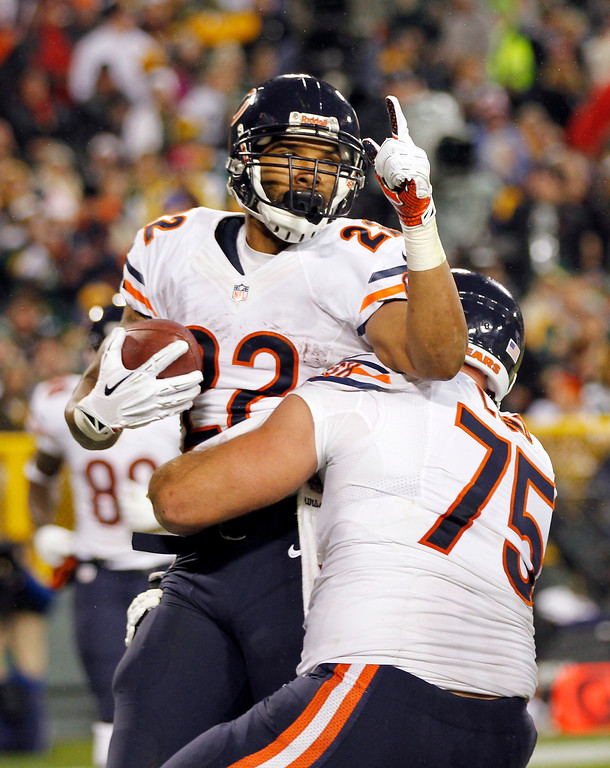. Chicago Bears\' Matt Forte (22) celebrates his touchdown run with teammate Kyle Long (75) during the first half of an NFL football game against the Green Bay Packers Monday, Nov. 4, 2013, in Green Bay, Wis. (AP Photo/Mike Roemer)