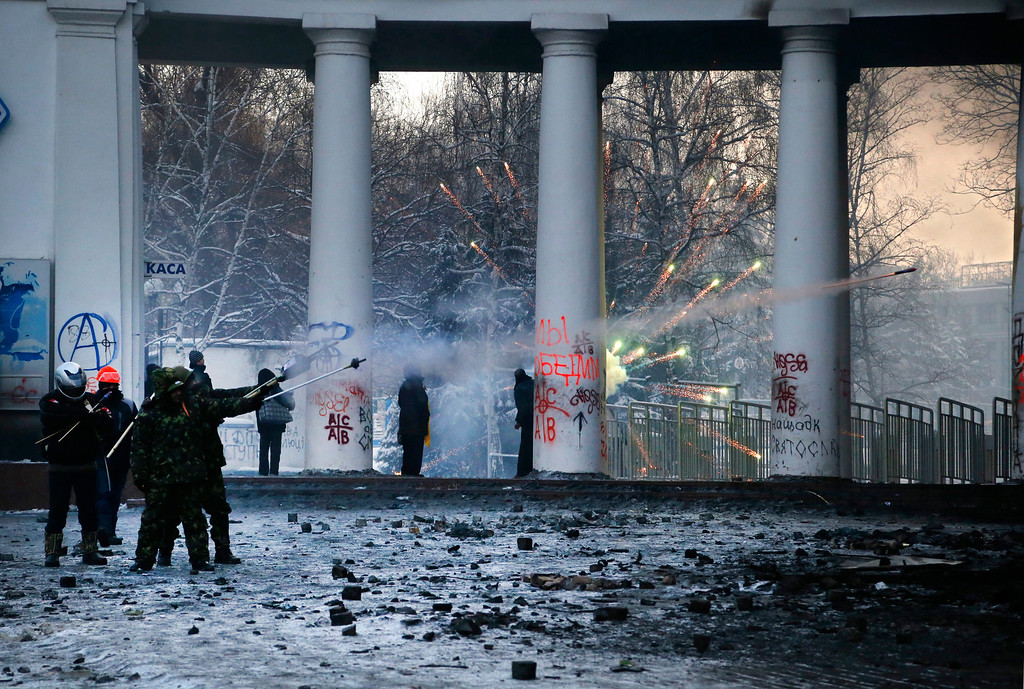 . Protesters aim fireworks at police during clashes, in central Kiev, Ukraine, Thursday Jan. 23, 2014.  (AP Photo/Sergei Grits)