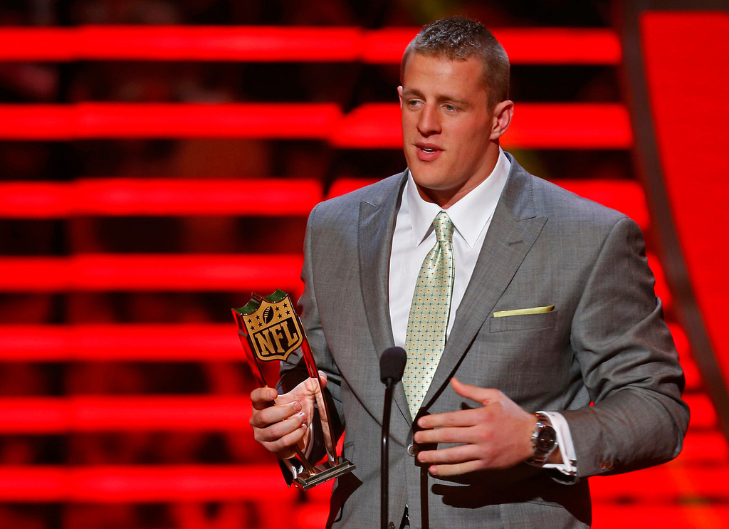 . Houston Texans defensive end J.J. Watt accepts the award for the NFL Defensive Player of the Year during the NFL Honors award show in New Orleans, Louisiana February 2, 2013.  REUTERS/Jeff Haynes