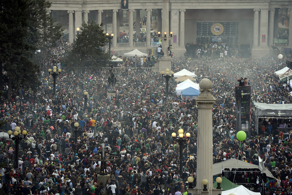". DENVER, CO. - APRIL 20TH: Thousands gather in Civic Center Park and light up for ""420\"" day Saturday afternoon, April 20th, 2013. (Photo By Andy Cross/The Denver Post)"