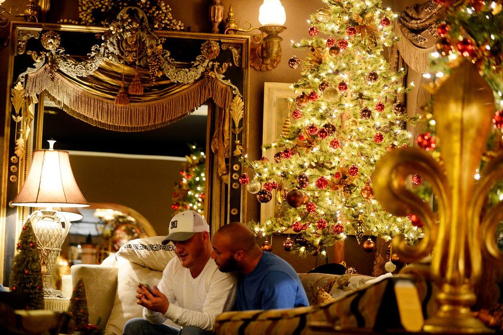 . Fred Samborski (left) and Luke Sky enjoy happy hour at Black Crown Lounge on Sunday, November 25, 2012. AAron Ontiveroz, The Denver Post