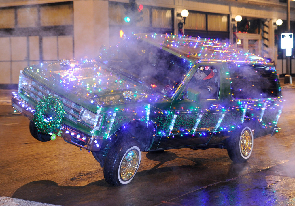 . DENVER, CO. - DECEMBER 06: A low riders club showed the Christmas spirit as the 9News Parade of Lights kicked off Friday night, December 6, 2013. The weather was clear but temperatures dipped below zero. Photo By Karl Gehring/The Denver Post