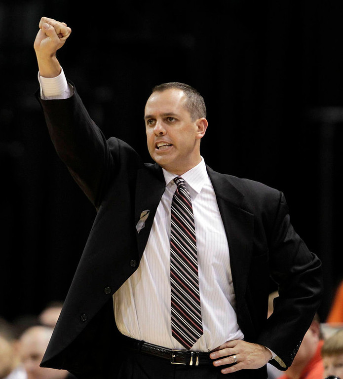. Indiana Pacers head coach Frank Vogel calls a play from the sidelines wile playing the Denver Nuggets during the first half of an NBA basketball game , in Indianapolis, Friday, Dec. 7, 2012. The Nuggets won 92-89. (AP Photo/AJ Mast)