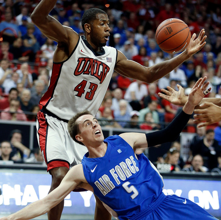 . UNLV\'s Mike Moser (43) and Air Force\'s Mike Fitzgerald (5) reach for a rebound during the first half of a Mountain West Conference tournament NCAA college basketball game on Wednesday, March 13, 2013, in Las Vegas. (AP Photo/Isaac Brekken)