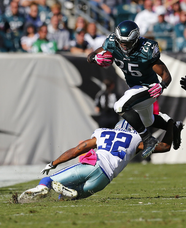 . Running back LeSean McCoy #25 of the Philadelphia Eagles leaps over cornerback Orlando Scandrick #32 of the Dallas Cowboys in the second quarter during a game at Lincoln Financial Field on October 20, 2013 in Philadelphia, Pennsylvania. (Photo by Rich Schultz /Getty Images)