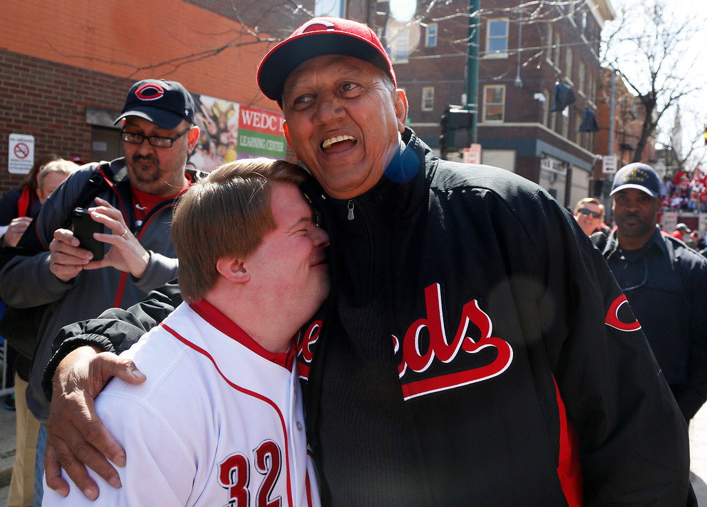 . Former Cincinnati Reds great Dave Concepcion hugs Teddy Kramer, left, prior to the start of the annual opening day parade, Monday, March 31, 2014, in Cincinnati. Concepcion was grand marshall of the parade. The Cincinnati Reds play the St. Louis Cardinals. (AP Photo/David Kohl)