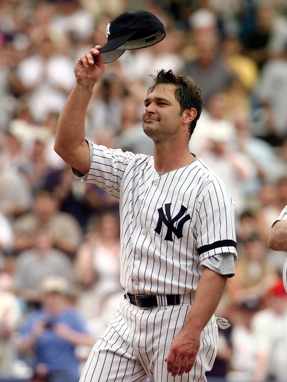 . DON MATTINGLY -- New York Yankees great Don Mattingly tips his cap to the crowd as he is introduced for the first time during Old Timer\'s Day ceremonies on Sept. 2, 2000, at Yankee Stadium in New York. (AP Photo/John Dunn)
