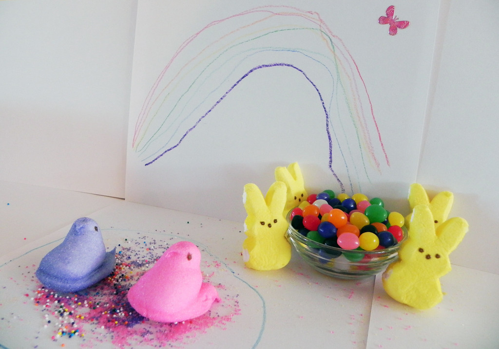. Peeps in Rainbowland by Mari Greunke, age 5.  (rainbow, pot of rainbow gold, peeps swimming in rainbow lake)