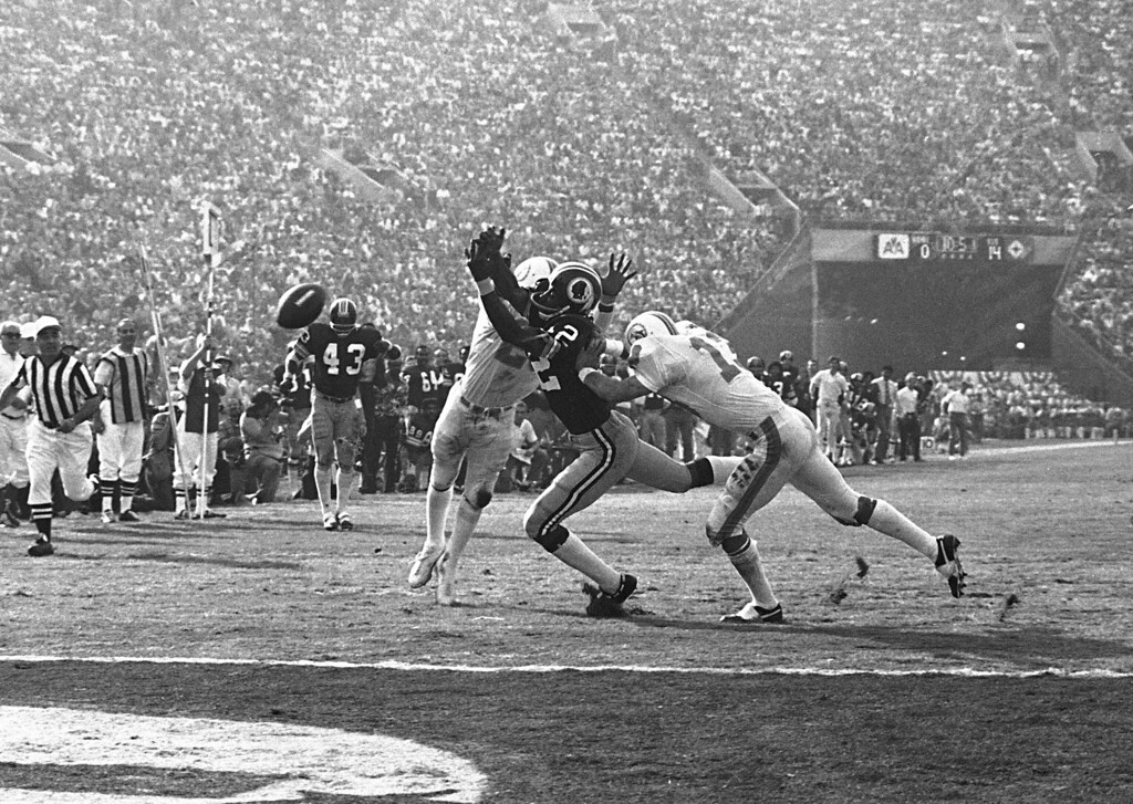 . Miami Dolphins\' Lloyd Mumphord, left, and Jake Scott (13) break up a pass to Washington Redskins\' Charley Taylor near the goal line to stop a Redskin drive in the third quarter of the Super Bowl game in Los Angeles, Jan. 14, 1973.  (AP Photo)