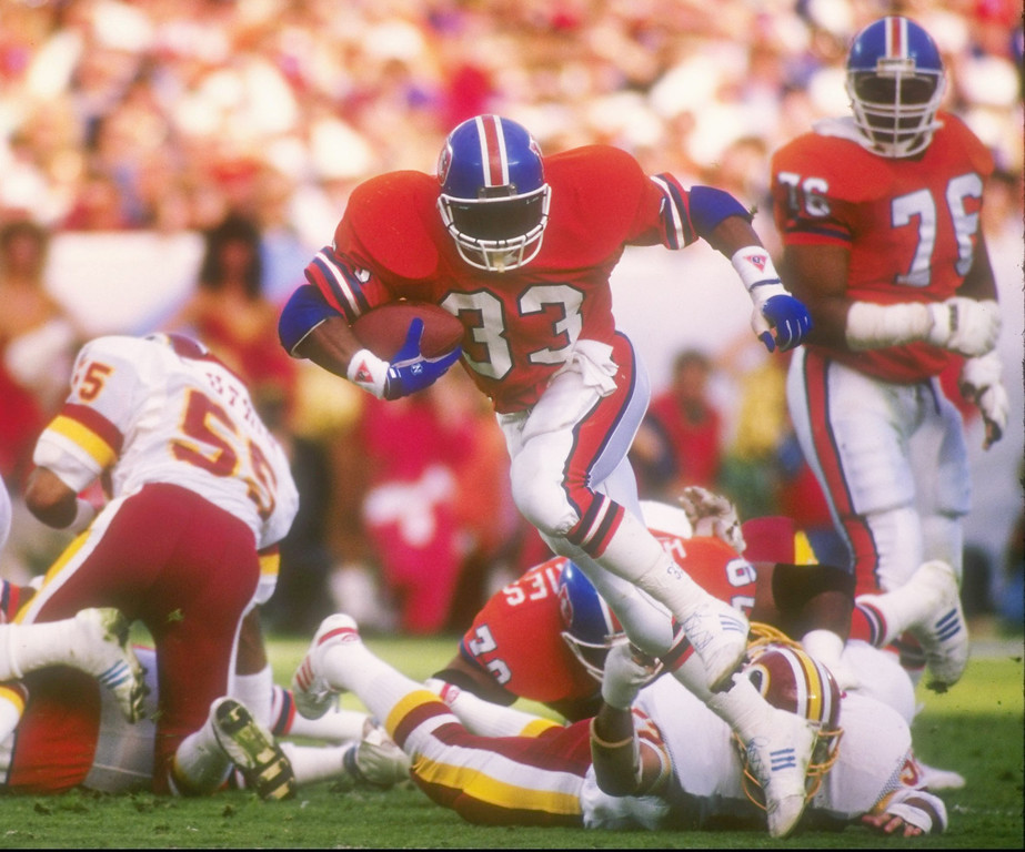 . Running back Gene Lang #33 of the Denver Broncos pushes through with the ball during Super Bowl  XXII against the Washington Redskins at Jack Murphy Stadium in San Diego, California, on Jan. 31, 1988.  The Redskins won 42-10.     Rick Stewart/Allsport