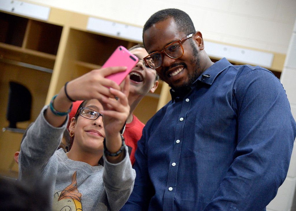 . Sofia Martinez, 10, takes a selfie with Von Miller after receiving her prescription glasses April 14, 2014. M  (Photo by John Leyba/The Denver Post)