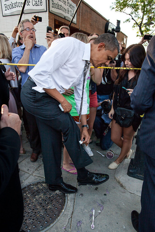". April 24, 2012 ""The President wipes off his trousers after being splattered by frozen yogurt while shaking hands along a ropeline in Boulder, Colo. University of Colorado student Kolbi Zerbest had placed her cup of yogurt on the ground while trying to shake hands with the President, and someone else inadvertently kicked the cup.\"" (Official White House Photo by Pete Souza)"