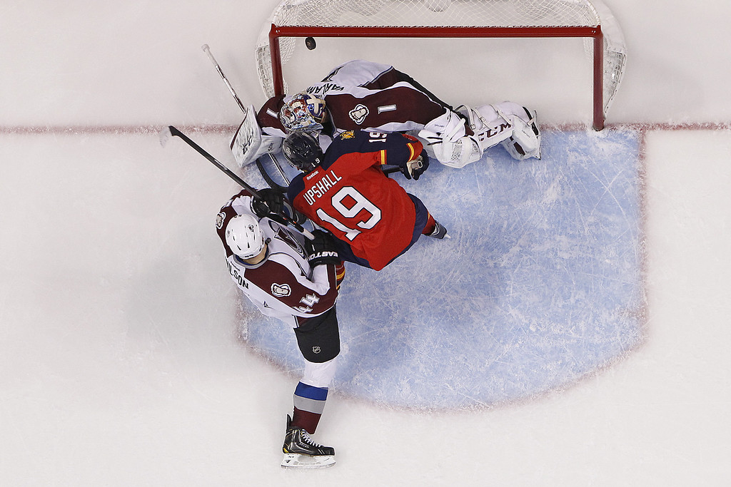 . SUNRISE, FL - JANUARY 24: Scottie Upshall #19 of the Florida Panthers scores his 100th NHL goal past goaltender Semyon Varlamov #1 of the Colorado Avalanche at the BB&T Center on January 24, 2014 in Sunrise, Florida. The Avalanche defeated the Panthers 3-2. (Photo by Joel Auerbach/Getty Images)