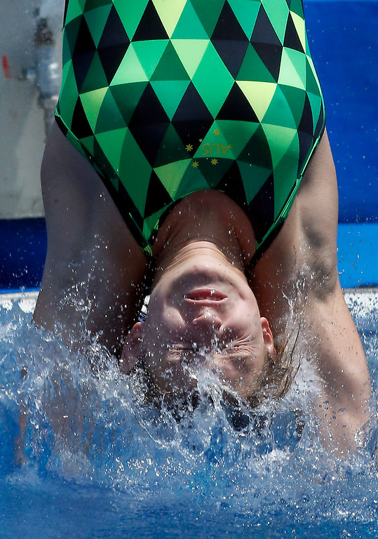 . Maddison Keeny from Australia dives during the women\'s 1-meter springboard preliminary at the FINA Swimming World Championships in Barcelona, Spain, Sunday, July 21, 2013. (AP Photo/Michael Sohn)