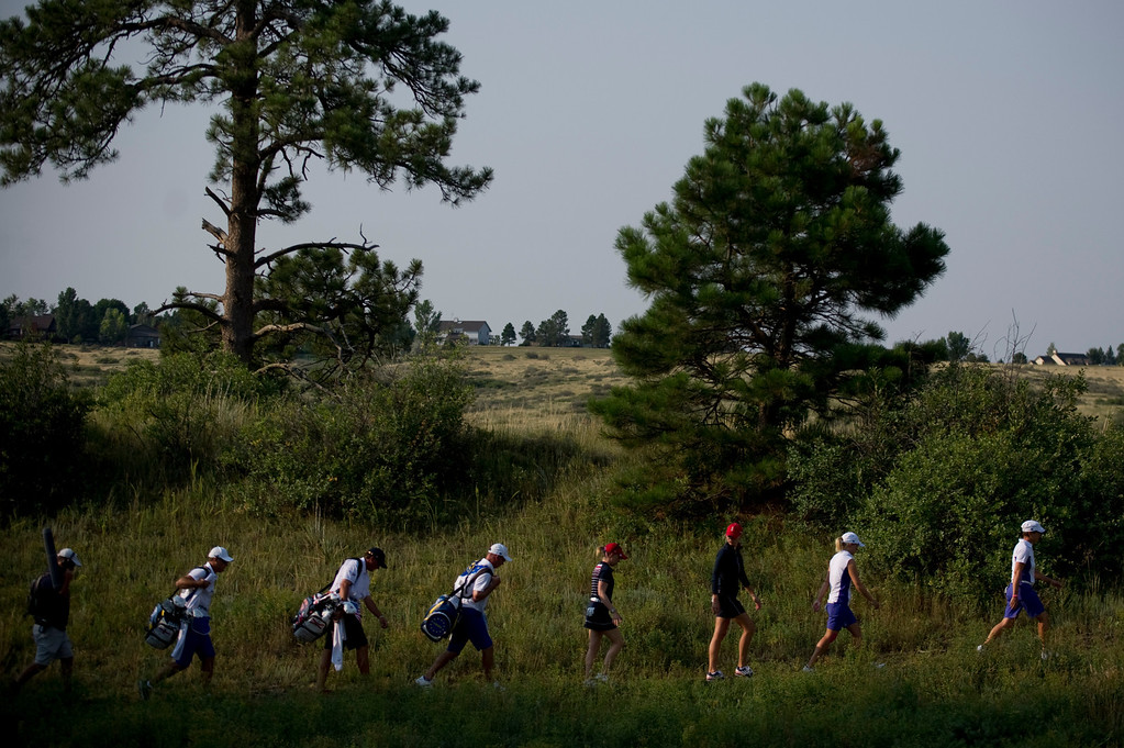 . PARKER, CO - AUGUST 16: Americans Jessica Korda and Morgan Pressel and Europeans Catriona Matthew and Jodi Ewart Shadoff walk with their caddies to the green on the second hole during the first day of the Solheim Cup at Colorado Golf Club, on August 16, 2013.  (Photo By Grant Hindsley/The Denver Post)