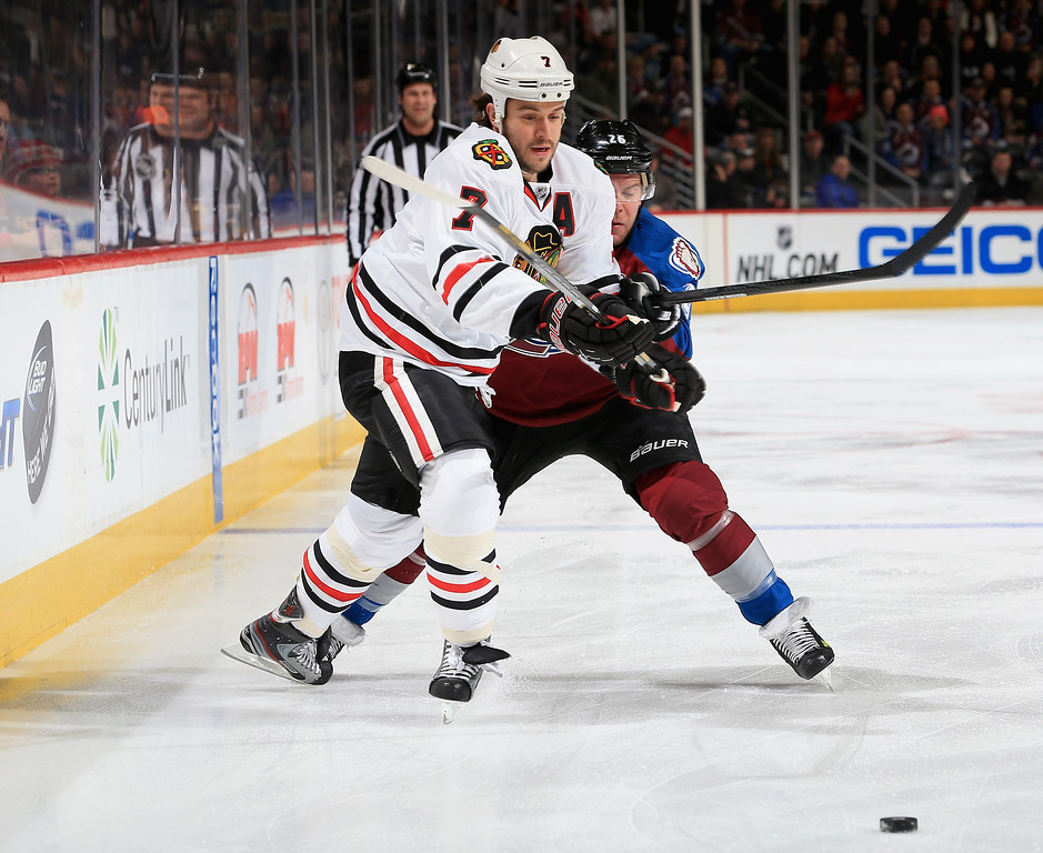 . DENVER, CO - MARCH 08:  Brent Seabrook #7 of the Chicago Blackhawks and Paul Stastny #26 of the Colorado Avalanche battle for control of the puck at the Pepsi Center on March 8, 2013 in Denver, Colorado.  (Photo by Doug Pensinger/Getty Images)