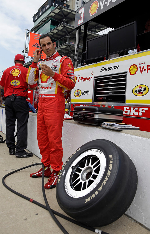 . Helio Castroneves, of Brazil, prepares to drive during practice for the Indianapolis 500 auto race at the Indianapolis Motor Speedway in Indianapolis, Thursday, May 16, 2013. (AP Photo/Michael Conroy)