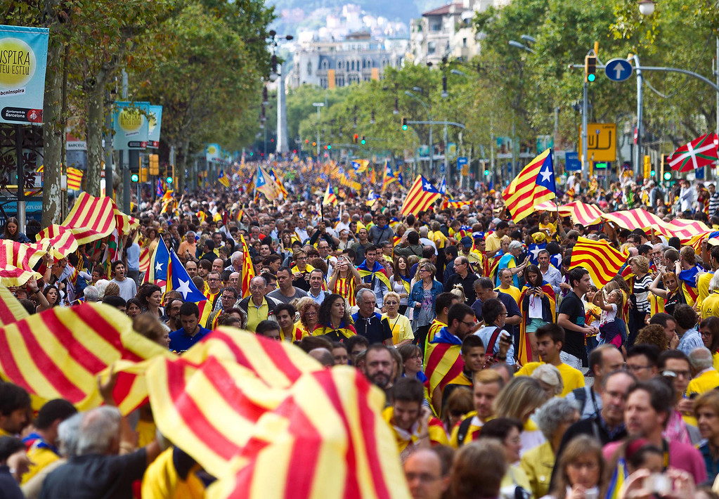 . People march along the street in Barcelona, Spain Wednesday Sept. 11, 2013. Several hundred thousand people demanding an independent Catalonia  joined hands in an attempt to form a 400-kilometer (250-mile) human chain across the northeastern region of Spain. The demonstration Wednesday aimed to illustrate local support for political efforts to break away from Spain. Organizers estimated about 400,000 people took part in the human chain. Catalonia claims a deep cultural difference based on its language, which is spoken side-by-side with Spanish in the wealthy region. (AP Photo/Joan Manuel Baliellas)