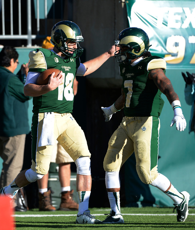 . Colorado State QB, Garrett Grayson, left, celebrates his touchdown with teammate, Donnell Alexander, against Air Force in the third quarter Saturday afternoon, November 30, 2013. The Rams won 58-13. (Photo By Andy Cross/The Denver Post)